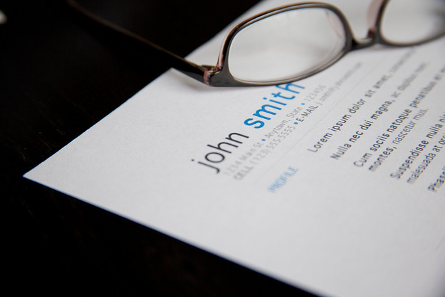 No mistakes in your best resume. Picture of resume with glasses.