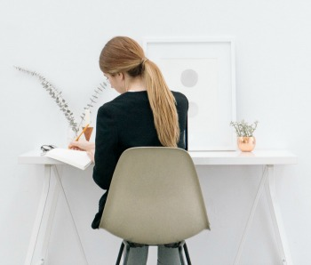 Woman creating a resume at her desk